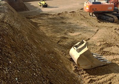 Planieren der Baugrube